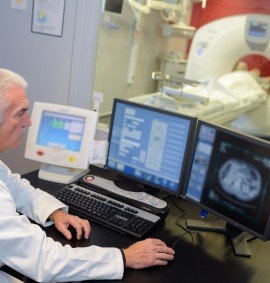 MRI technologist monitoring the screen