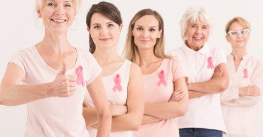 Multigenerational women with pink ribbons in breast cancer foundation