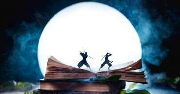 An open book with two ninja warrior silhouettes fighting in full Moon. Reader imagination and writing inspiration concept with copy space